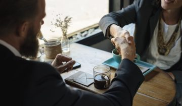 client trust and loyalty shaking hands